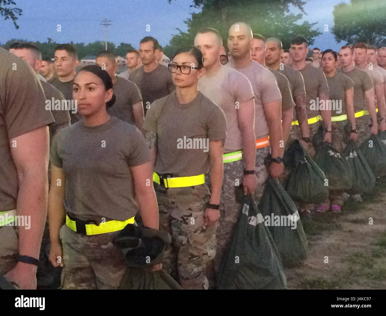 air assault students hold their wet weather bag with required packing list items in preparation for a two mile run at camp gruber training center in braggs