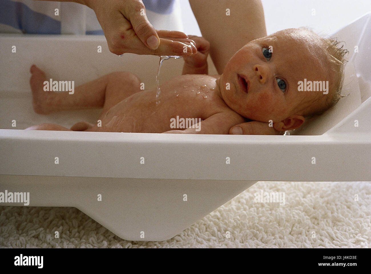 Baby tub, mother, detail, hands, baby, have a bath inside, at home ...