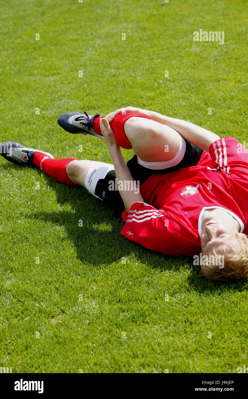 Turfs, football players, lie, hold shank, pains football match, man, player, pain, injury, foul, sports injury, - Stock Image