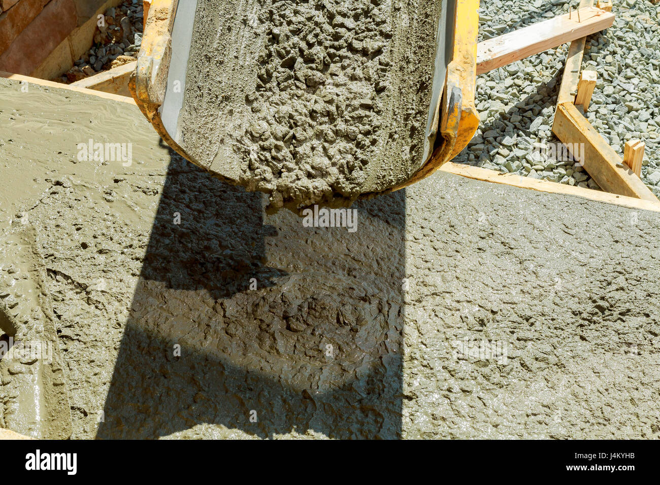 Pouring cement during Upgrade to residential street Concrete pouring during concreting Stock Photo