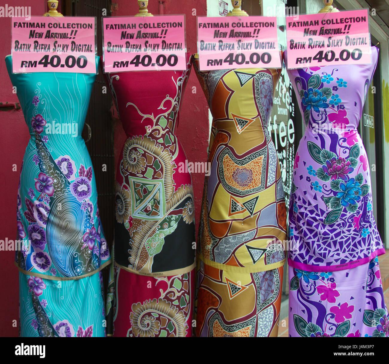 'Digital batik' gowns displayed on mannequins in a shop in Kampung Cina (Chinatown),Kuala Terengganu, Terengganu - Stock Image