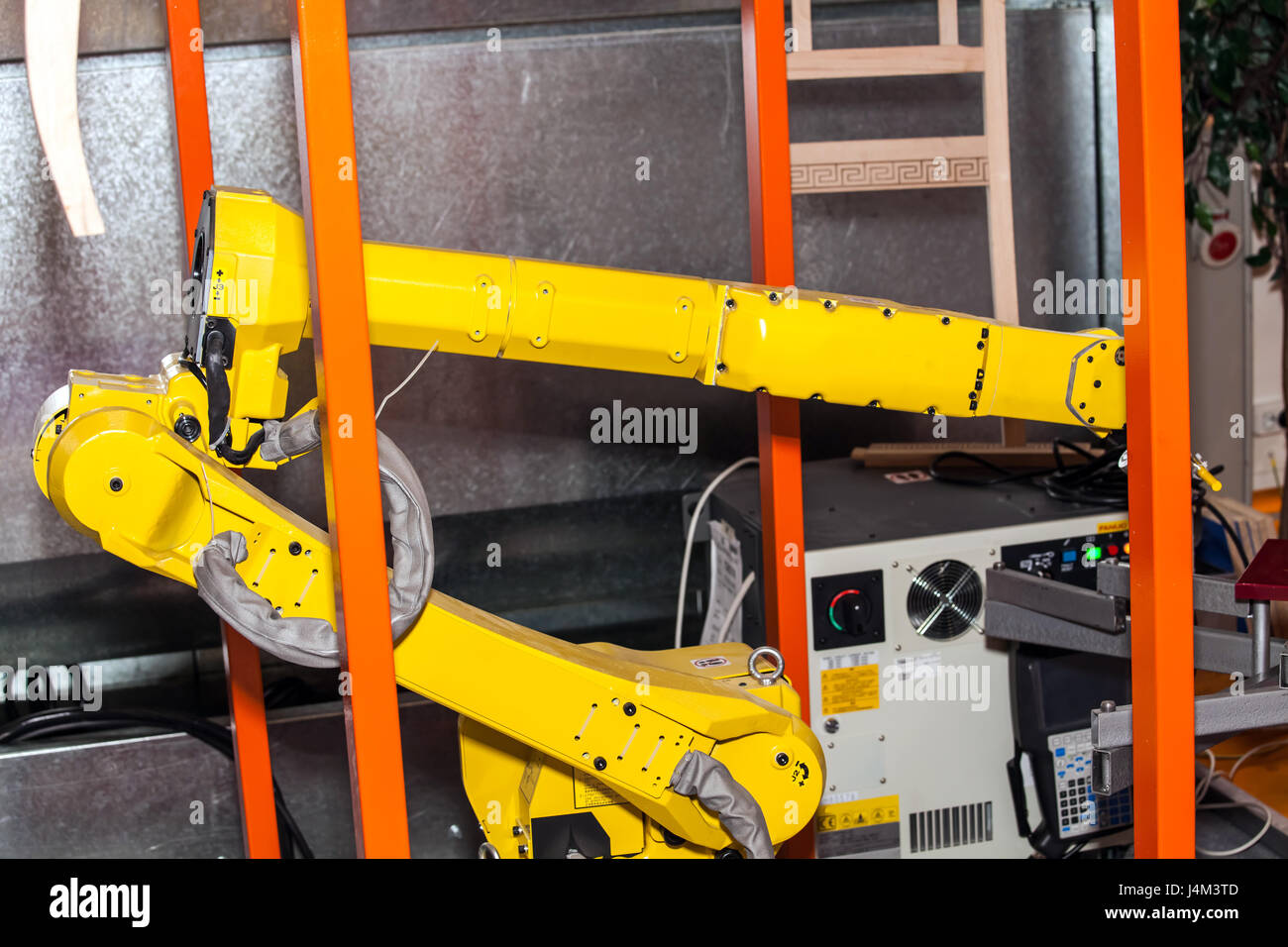 Industrial robot hand on the factory - Stock Image