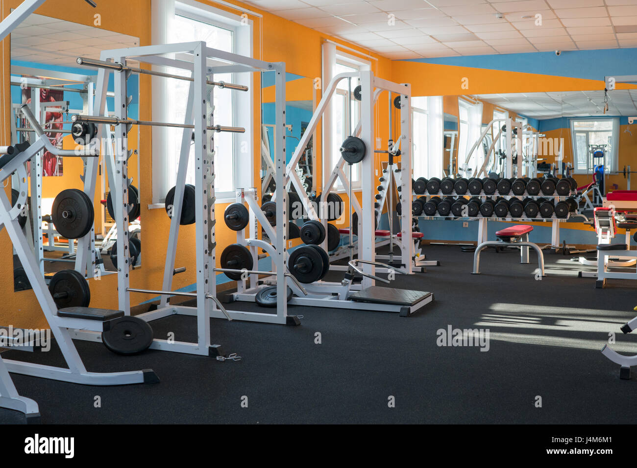 Modern fitness gym with exercise machines - Stock Image
