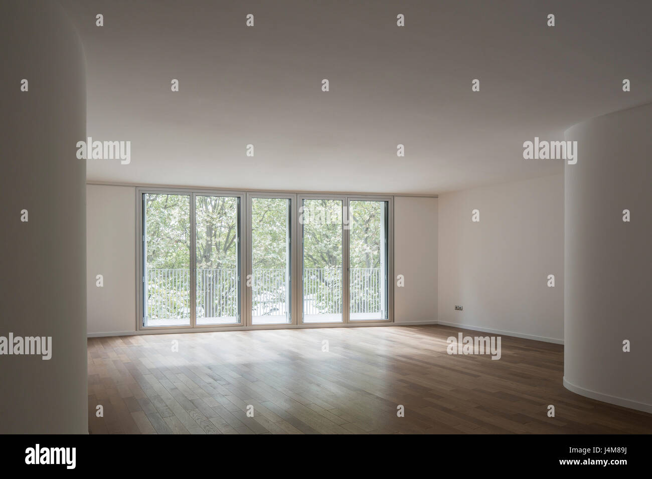 Unfurnished building interior with fenestration and balconies. Housing Building, Quai Henri IV, Paris, France. Architect: - Stock Image