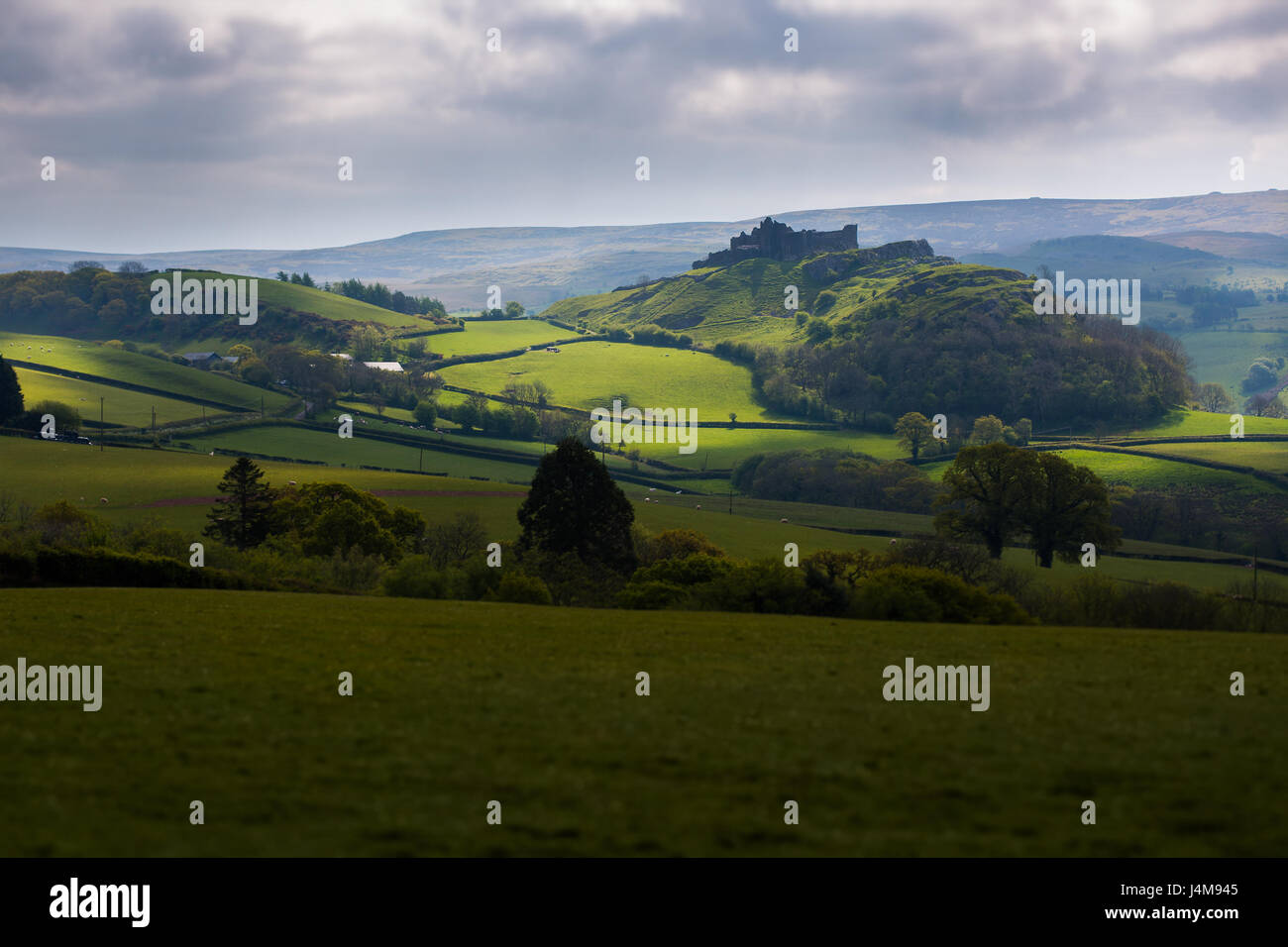 Dramatic Silhouette of Carreg Cennen Castle in the Beautiful Rolling Countryside of Carmarthenshire, Wales, UK - Stock Image