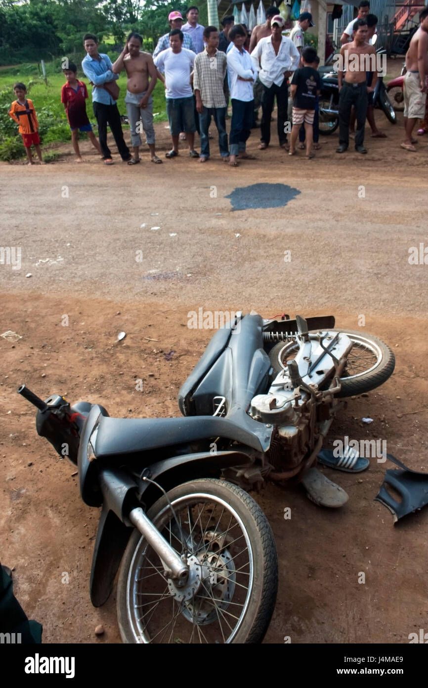People are gathered at the scene of a motorcycle accident in Chork village, Tboung Khmum province, Cambodia Stock Photo