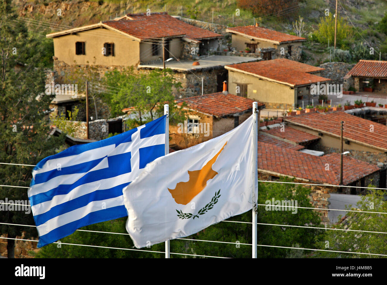 Greek and Cypriot flag, side by side at Fikardou village, one of the most beautiful mountainous villages of Cyprus, - Stock Image