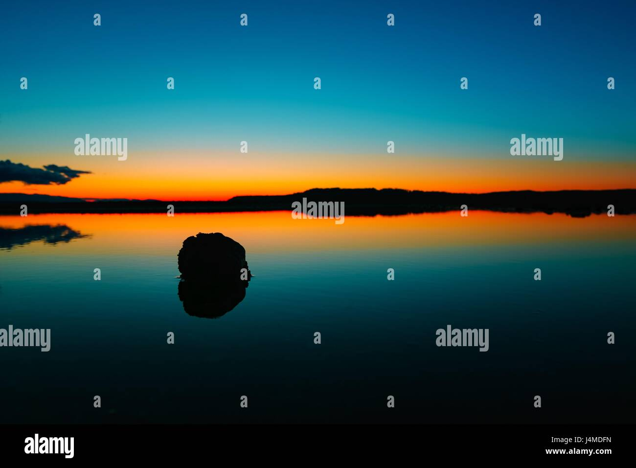 Beautiful after the sunset photography on a serene lake in Seattle, WA with the red orange sunset sky afterglow - Stock Image