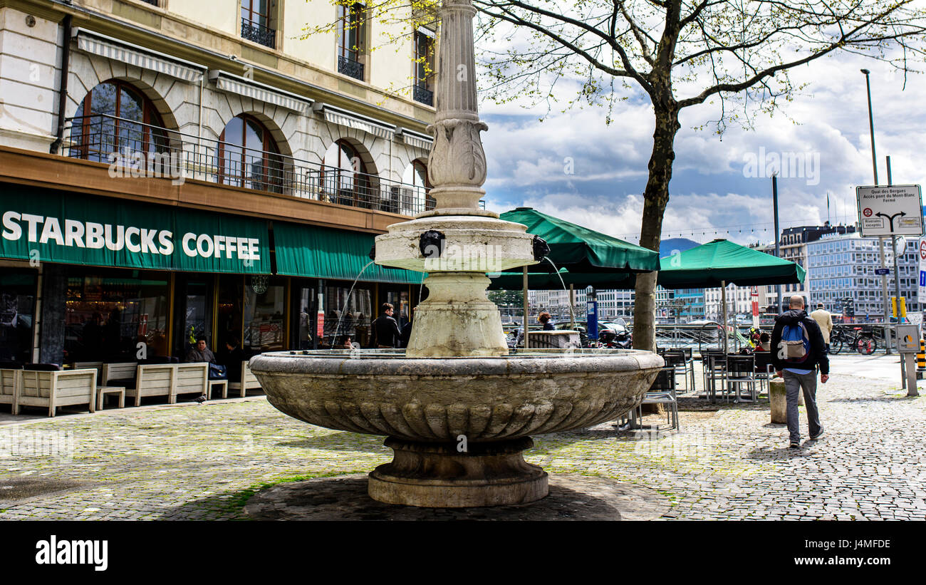 Geneva, Switzerland. April 13, 2016. Source at the confluence of Rue Rousseau and the Quai des Bergues at the entrance - Stock Image