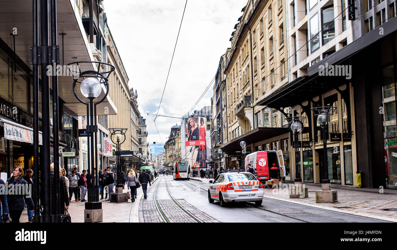 Geneva, Switzerland. April 13, 2016. People buying and strolling along the Rue du Marche, the shopping street of - Stock Image