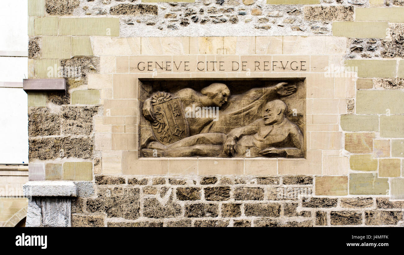 Geneva, Switzerland. April 13, 2016. statue and inscription that says 'Geneva, city of refuge' in the tower - Stock Image