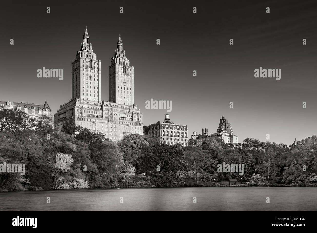 Sunrise on Upper West Side buildings and Central Park Lake (Black & White). Manhattan, New York City Stock Photo