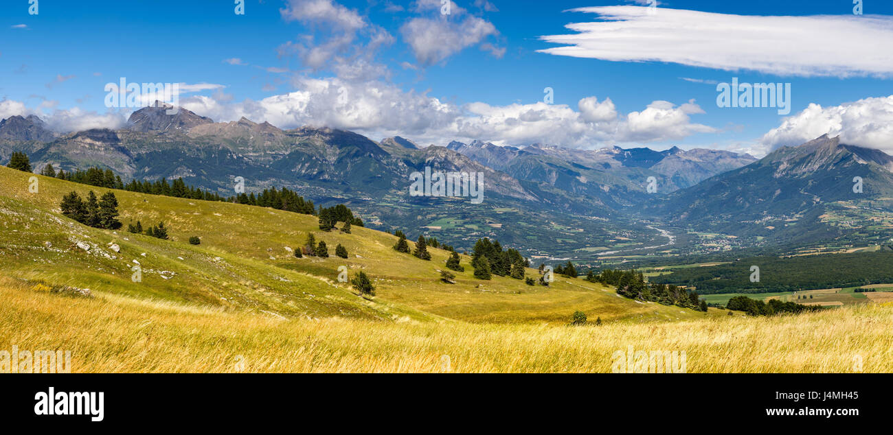 Panoramic view on the Champsaur and the Drac River Valley in summer from Gleize Pass. Hautes-Alpes, Southern French - Stock Image