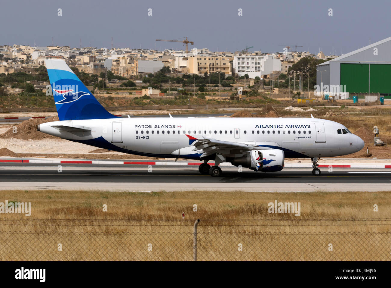 Atlantic Airways Airbus A320-112 [OY-RCI] landing runway 31. - Stock Image