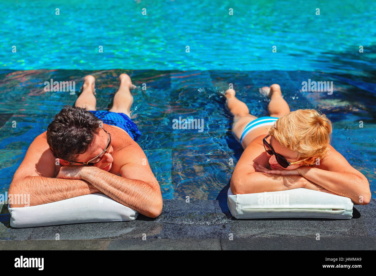 Successful retirement recreation, summer vacation concept. Retired mature couple enjoying beautiful sunny day in - Stock Image