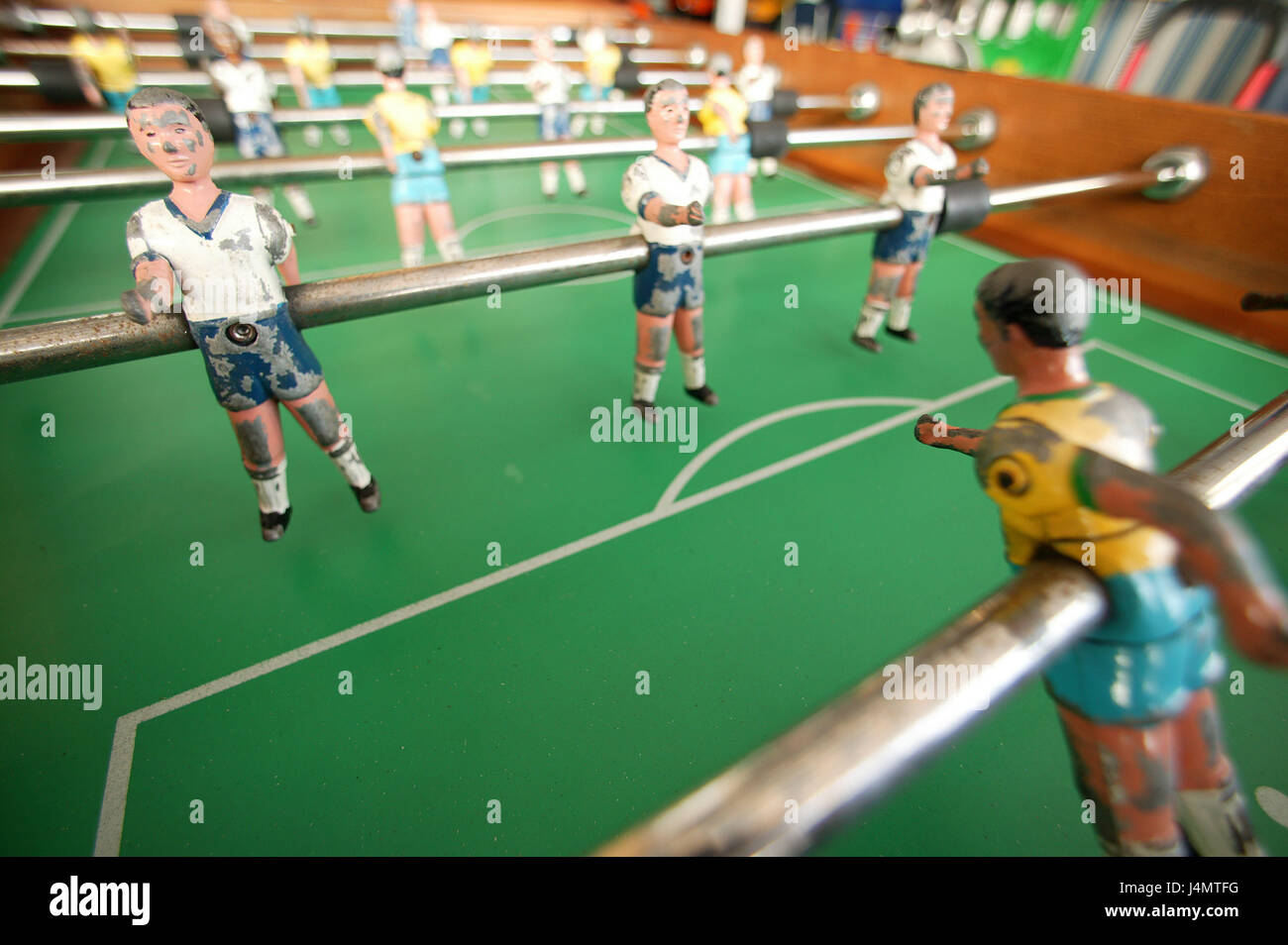 Table football, old, detail table football match, football player, leisure time, entertainment, game, sticks, characters, - Stock Image