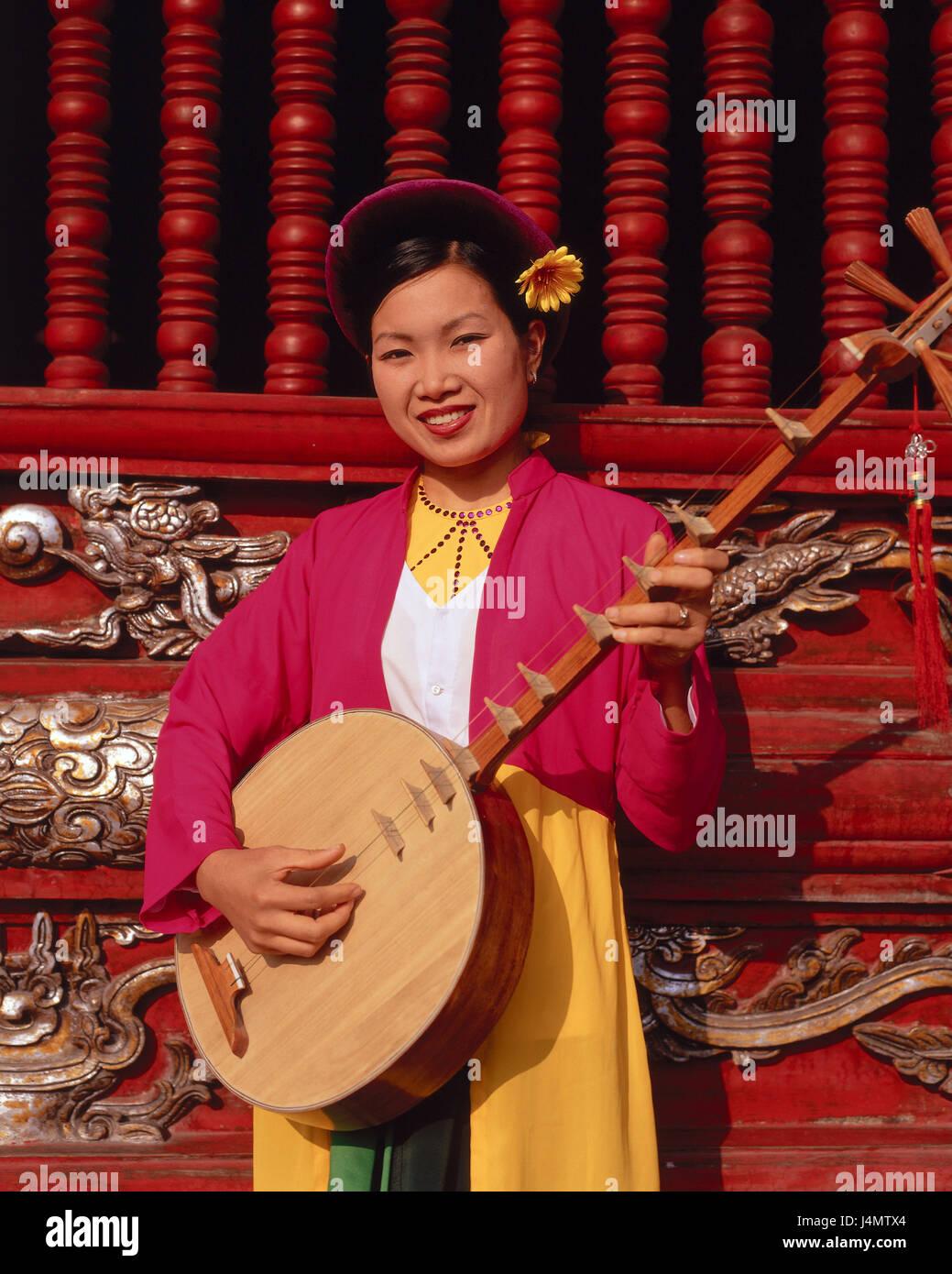 Vietnam, Hanoi, temple of the literature, woman, smile, stringed instrument, Dan Nguyet, half portrait Asia, South - Stock Image