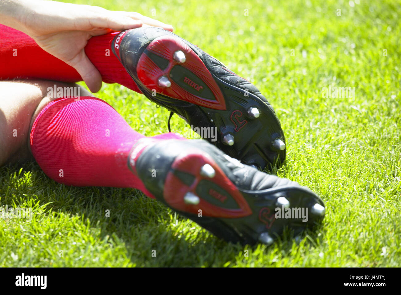 Turfs, football players, detail, bones, pains, touch football match, man, player, lie, pain, injury, foul, sports - Stock Image