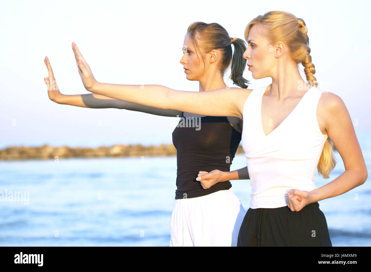 Beach Women Leisurewear Yoga Exercises At The Side 20 30 Years Friends Friendship Tai Chi Shadow Speakers Meditation Meditate