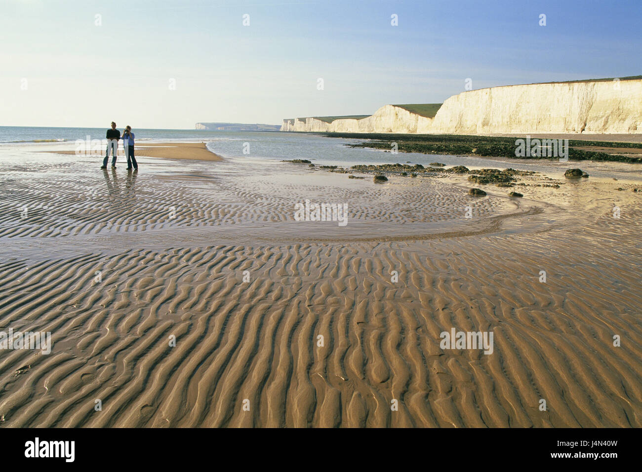 Great Britain, England, Sussex, Eastbourne, Seven Sisters, Beachy Head, rock, beach, couple, walk, no model release, - Stock Image