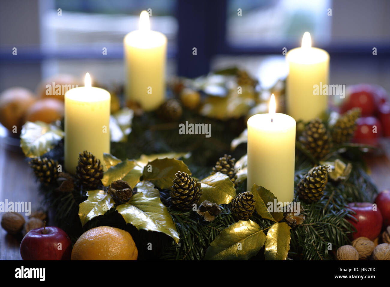 Advent wreath, four burning skyers, the fourth Advent, apples, Advent, Advent wreaths, Advent wreaths, Advent wreath, - Stock Image