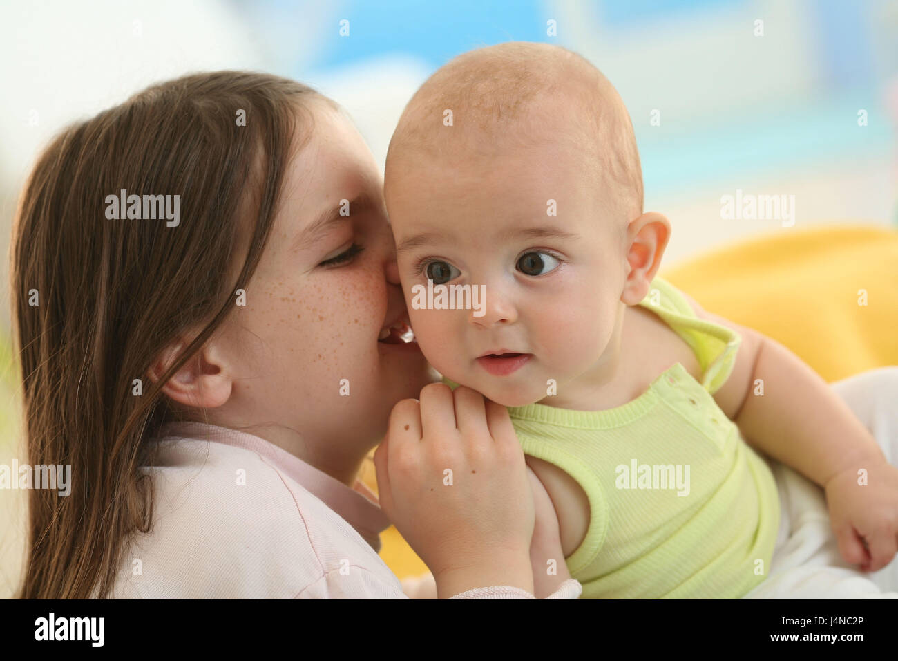 Baby, 5 months, child, 6 years, siblings, whisper, portrait, - Stock Image