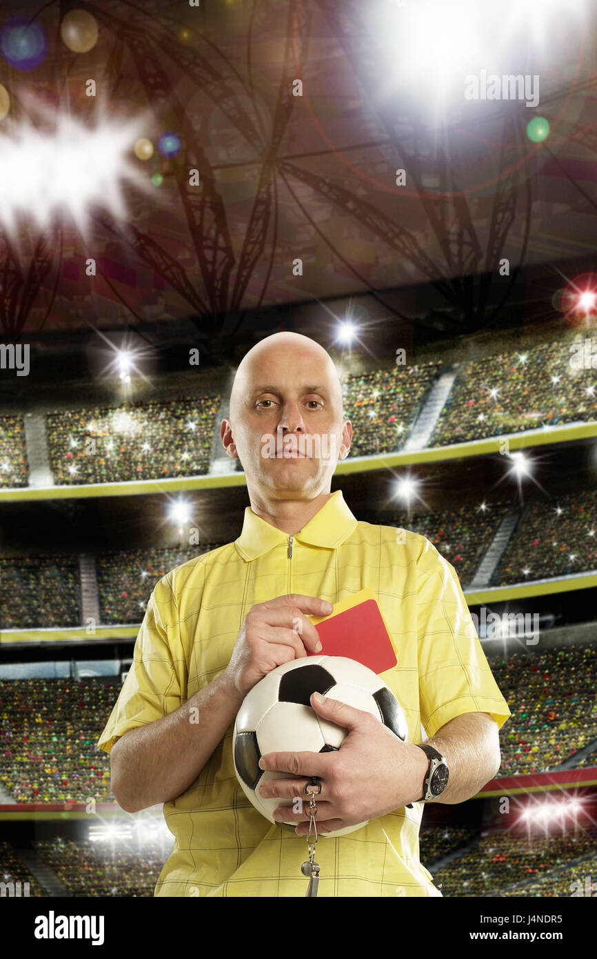 Referees, half portrait, football stadium, crowd of spectators, ball, Red, yellow, card, hold, model released, - Stock Image