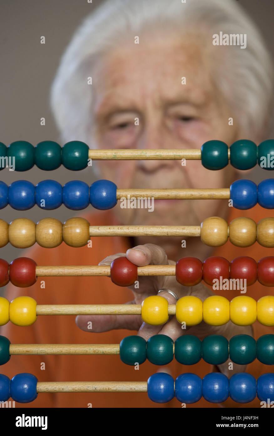 Senior, slide rule, concentration, portrait, curled, blur, person, pensioner, woman, arithmetic practise, arithmetic - Stock Image