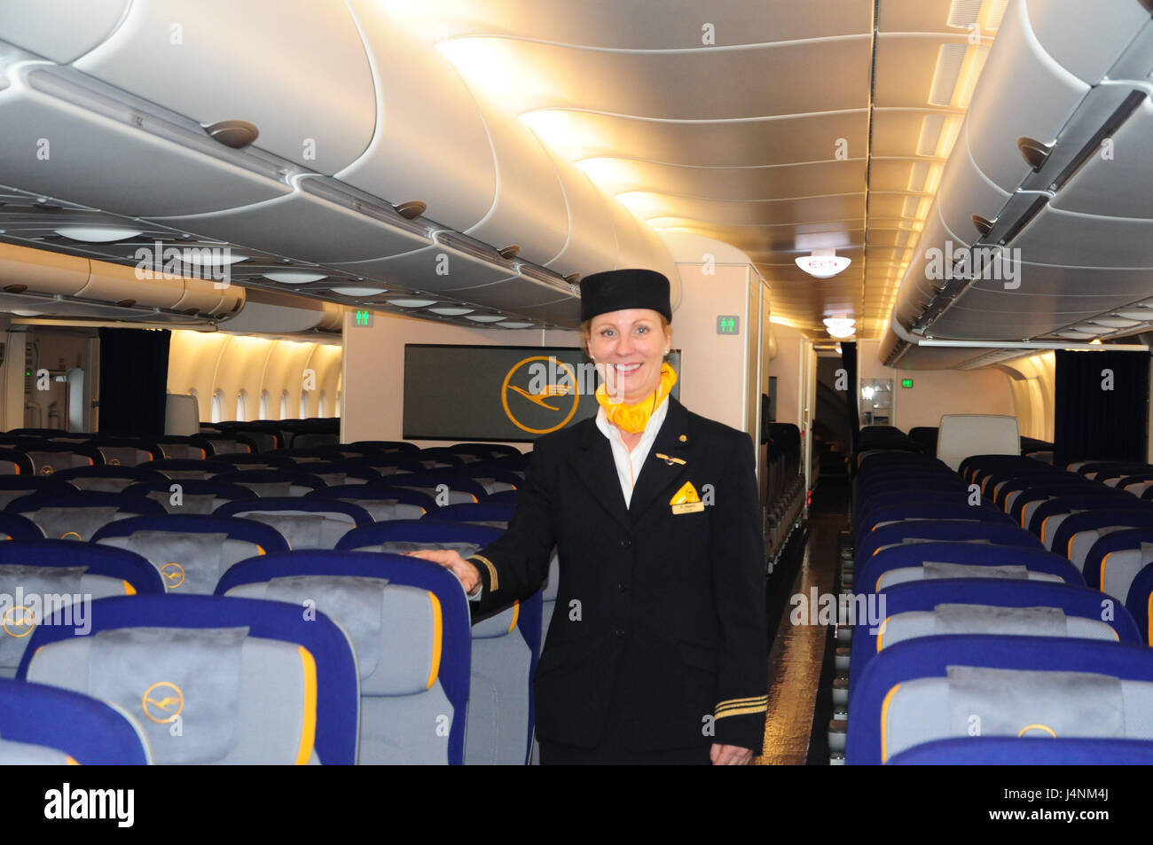 Airplane, inside, seats, flight attendant, air liner, seats, places, lighting, travel, vacation, people, stewardess, - Stock Image