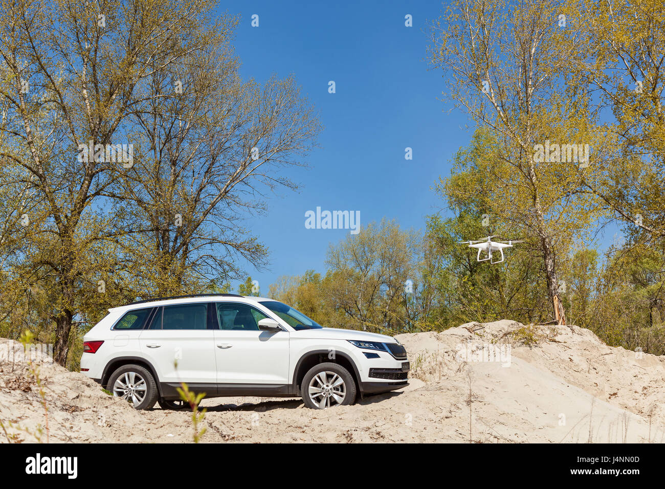 Ukraine, Kyiv 25 april 2017  car Skoda Kodiaq 2.0 TDi  quadcopter takes off video and photo of car from air - Stock Image