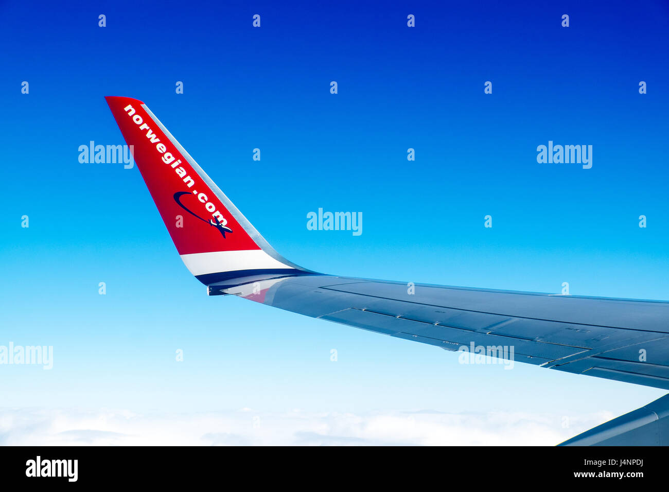 A Norwegian.com plane in flight. Norwegian is one of the new breed of budget airlines Stock Photo