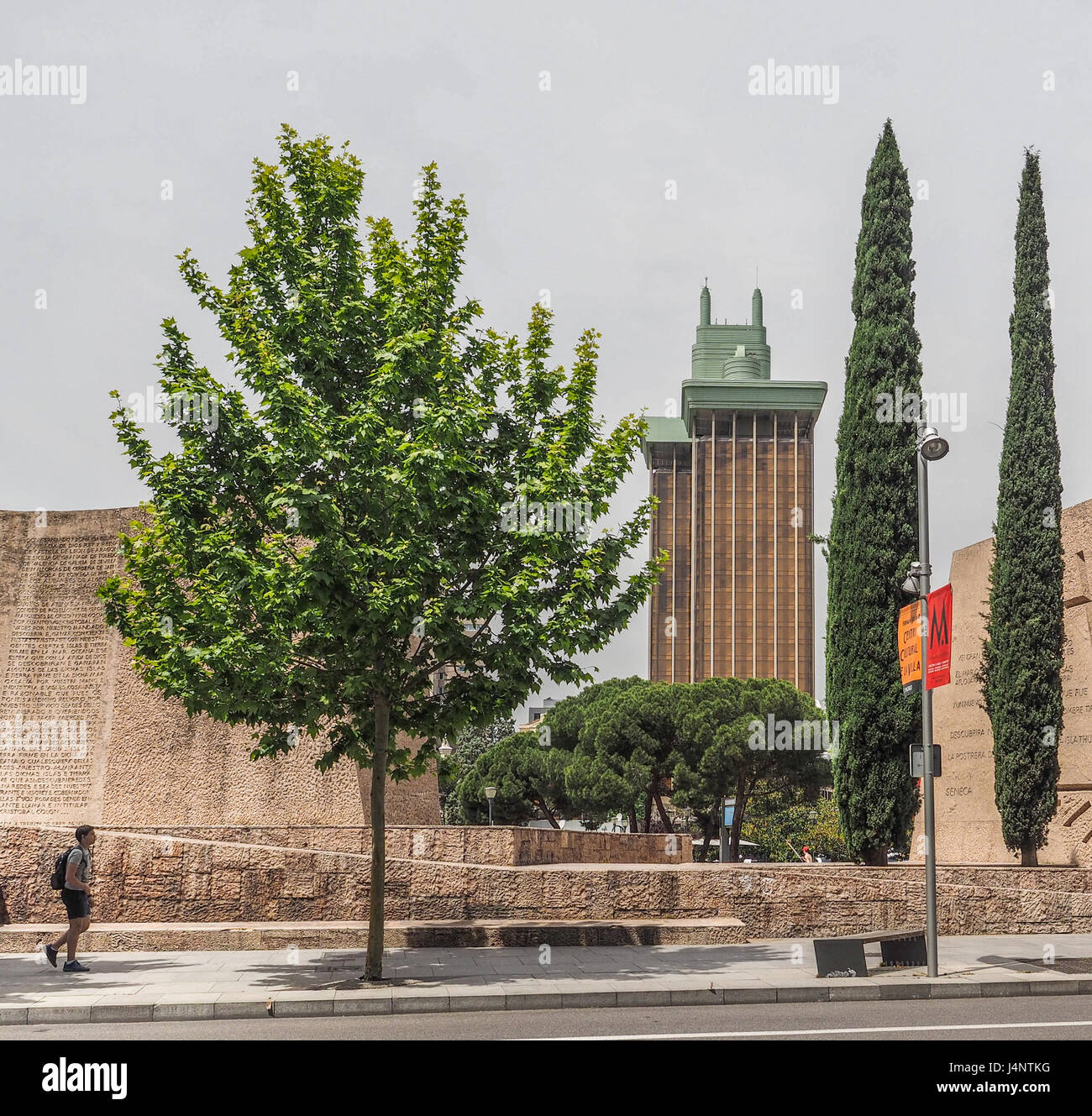 a view of Torres Colon towers through Plaza Colon and Jardines del Descubrimiento Monument trees Discovery of America - Stock Image