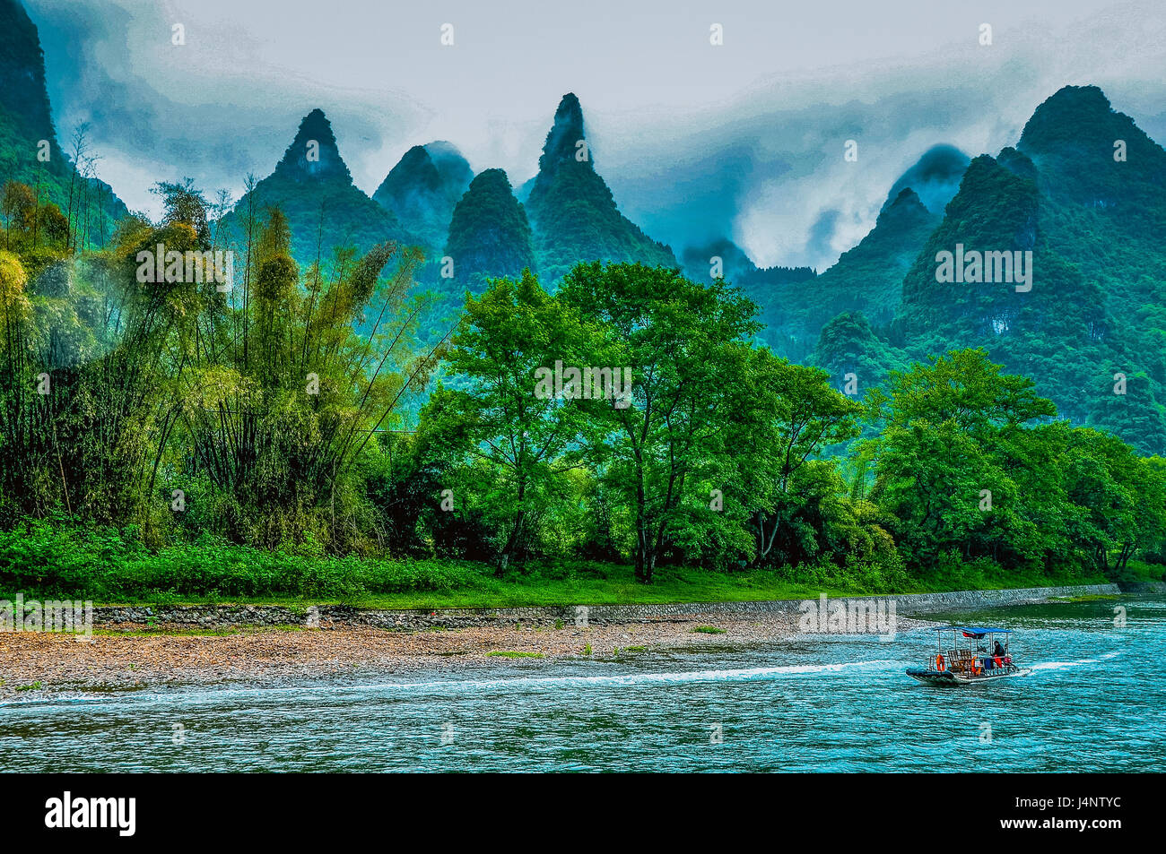 Karst mountains and Li River scenery in the mist Stock Photo