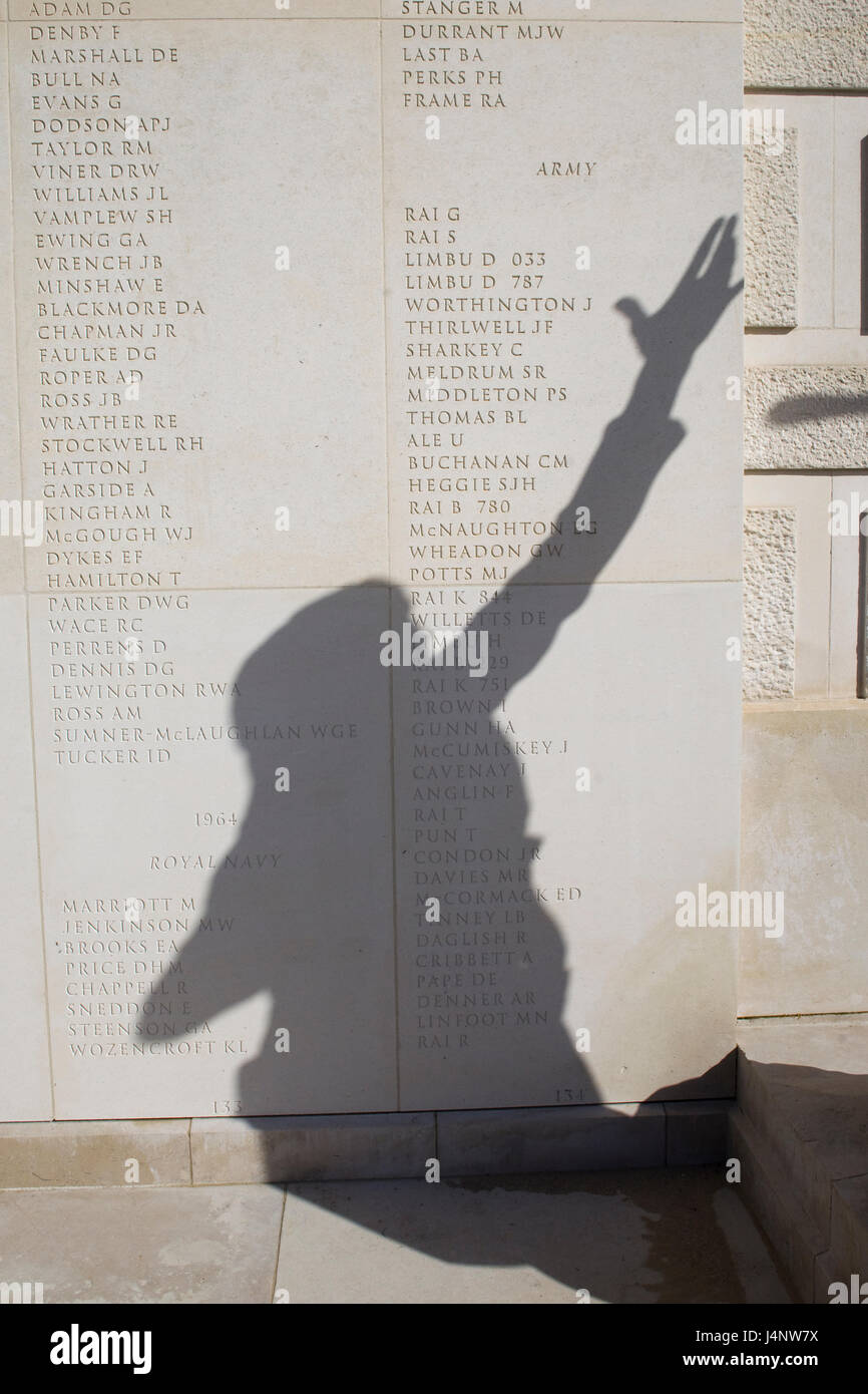 Shadow of a falling girl hand in the air at the war memorial - Stock Image