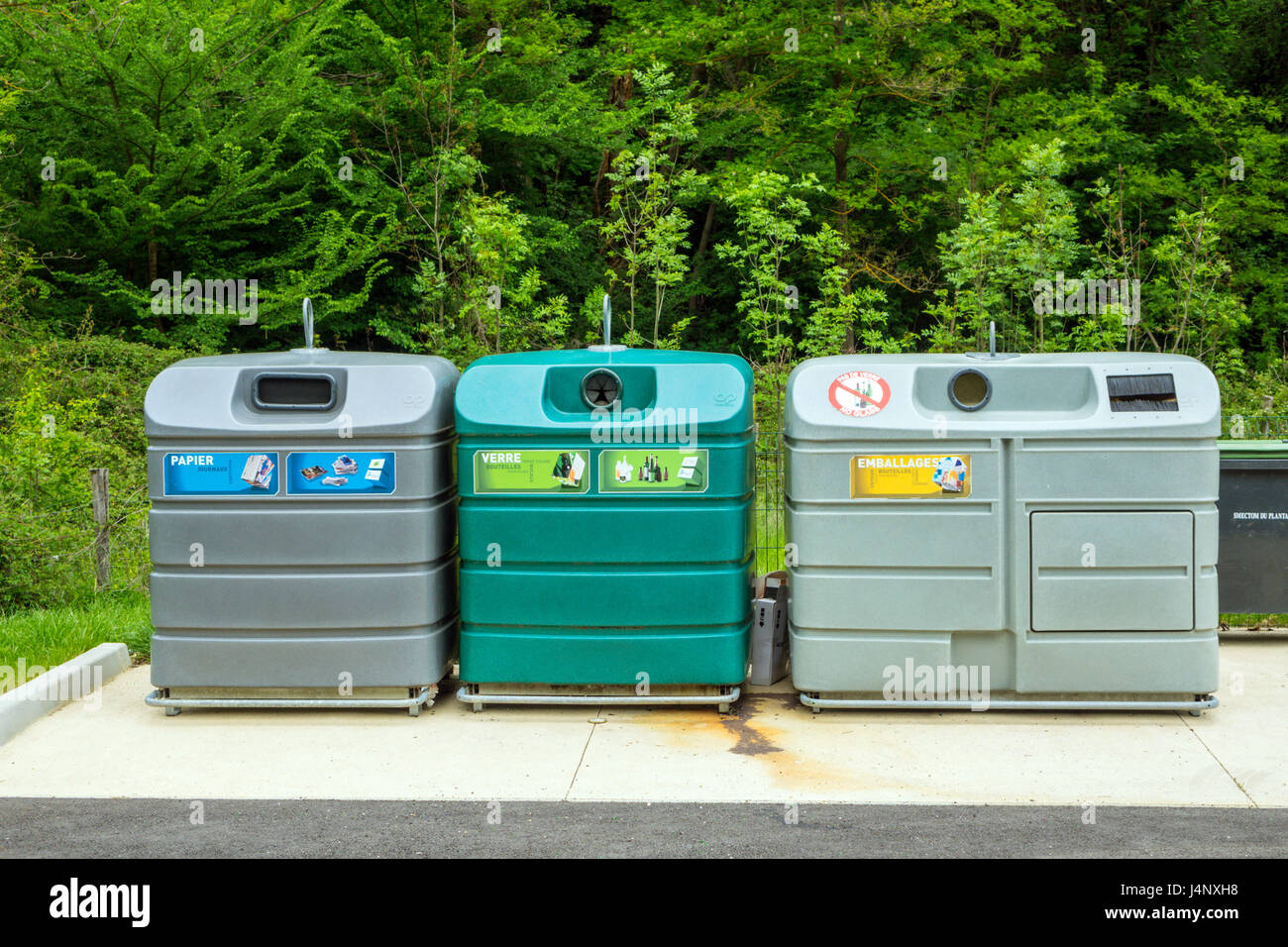 Large coloured recycling bins for glass paper and packaging Stock Photo