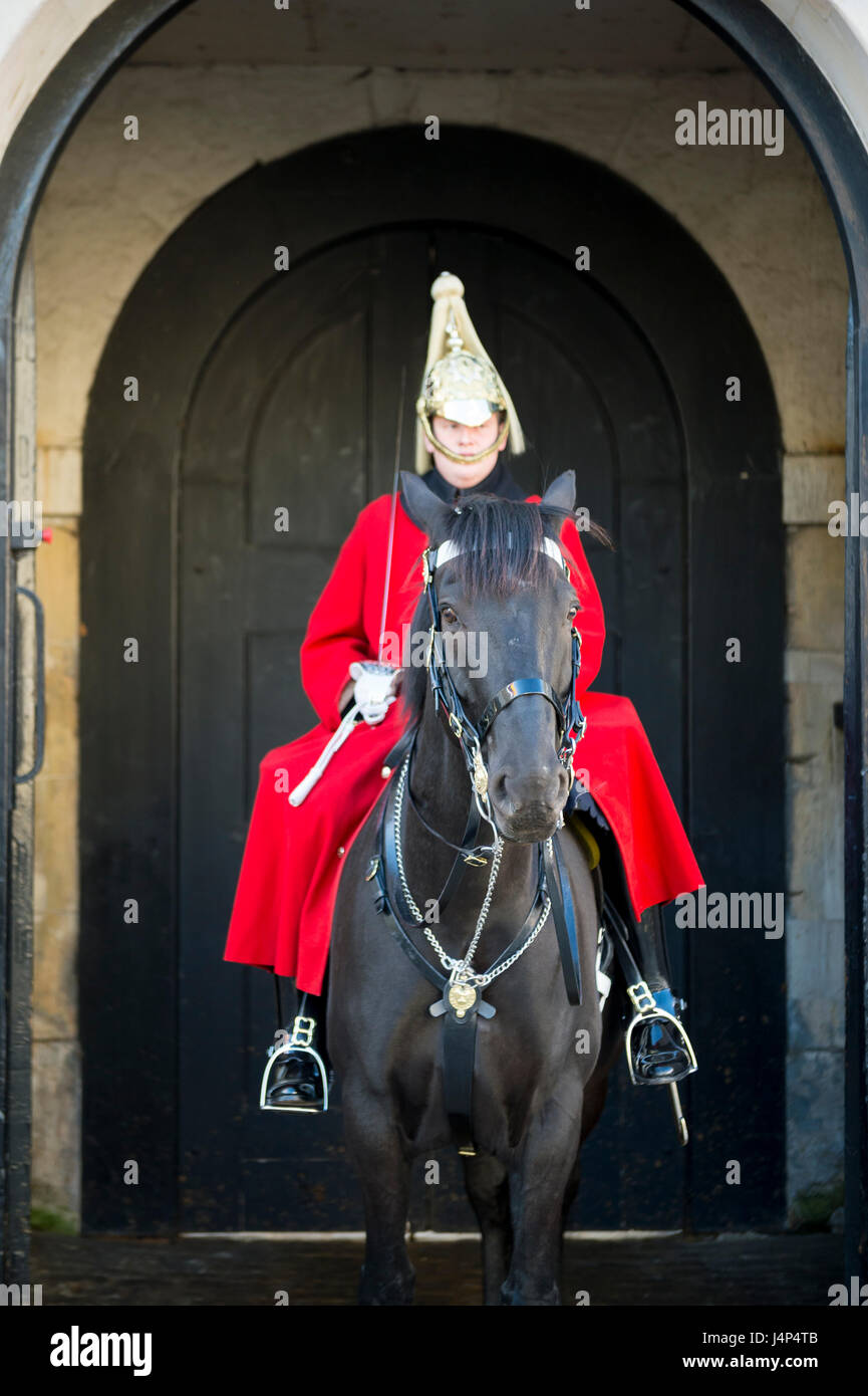 LONDON - OCTOBER 31, 2016: Mounted Queen's Life Guard of the Household Cavalry stands in an archway at St James's - Stock Image