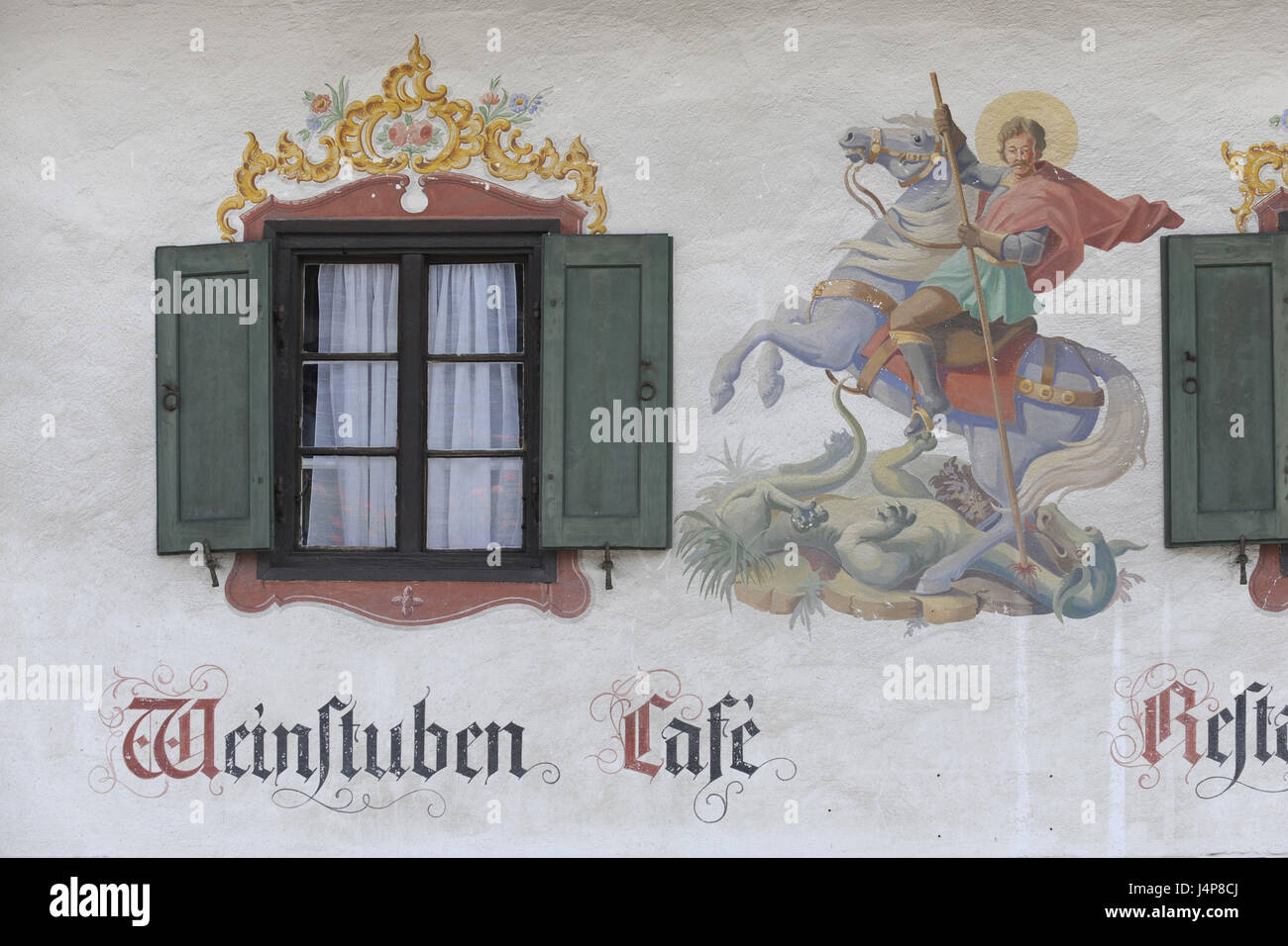 Lüftlmalerei of the holy piece Georg fights with the dragon on a house facade in Schliersee, - Stock Image