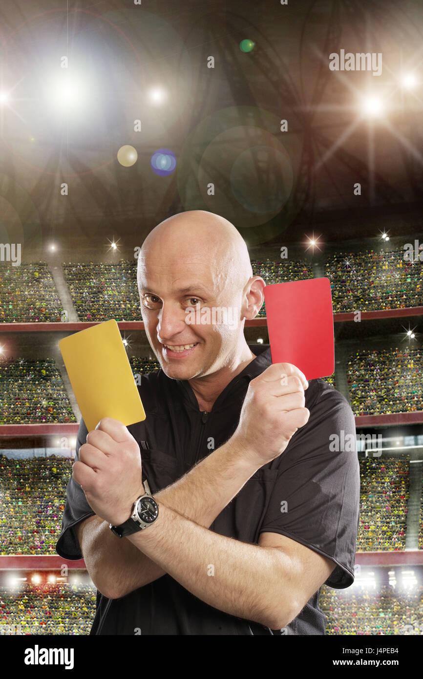 Referees, half portrait, smile, football stadium, crowd of spectators, Red, yellow, card, pointing, black, jersey, - Stock Image