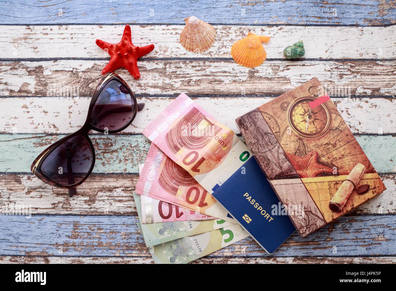 Travel concept: seashells, sunglasses, passport, money and journal on vintage table Stock Photo