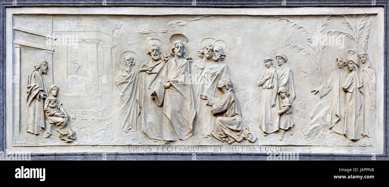 TURIN, ITALY - MARCH 15, 2017: The relief of jesus and rich young ruler on the facade of church Basilica Maria Ausiliatrice - Stock Image