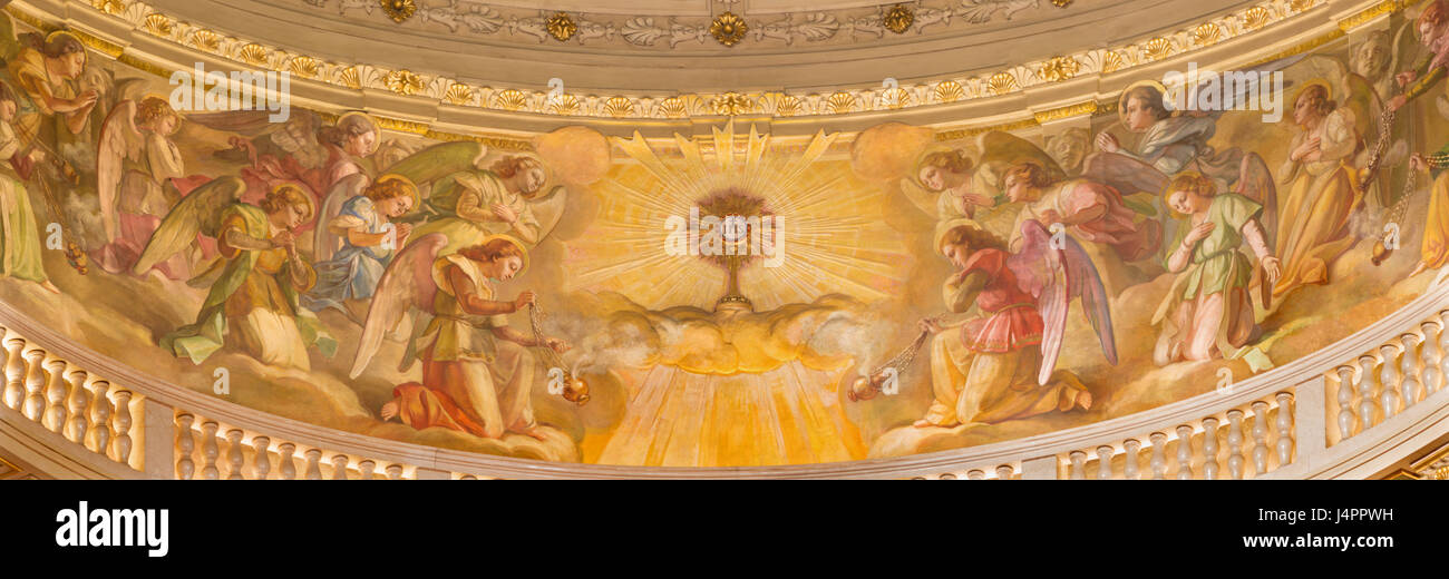 TURIN, ITALY - MARCH 15, 2017: The fresco of Eucharistic adoration of angels in cupola of church Basilica Maria - Stock Image