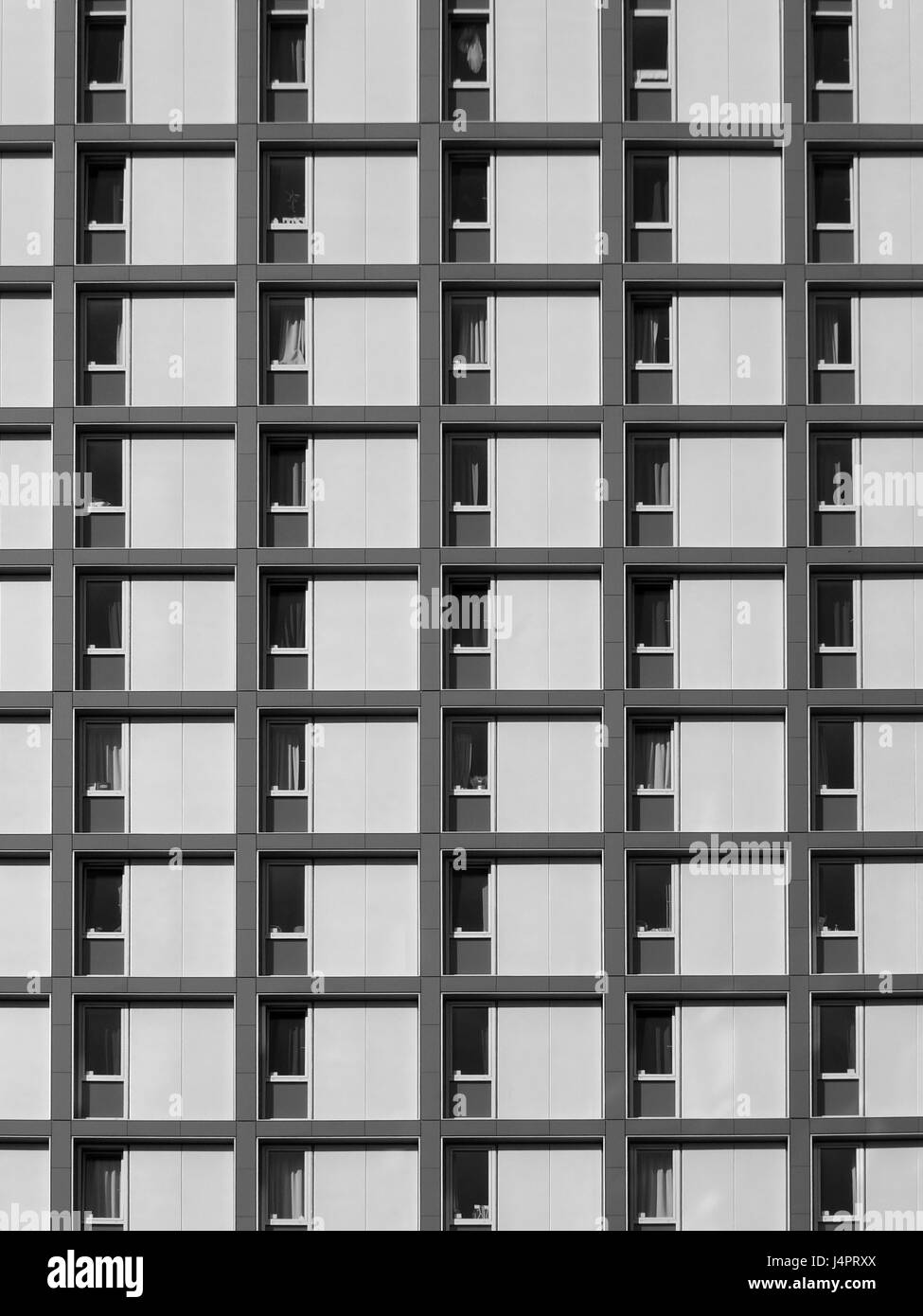 modern concrete housing development with repeating pattern windows Stock Photo