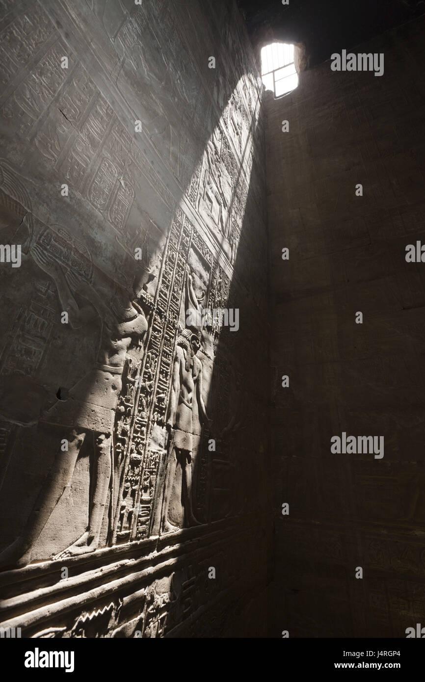 Wall reliefs, beam of light, Horus temple, Edfu, Egypt, - Stock Image