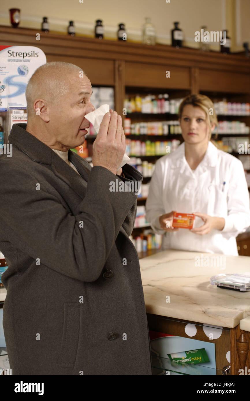 Chemist's shop, chemist, customer, sneeze, - Stock Image