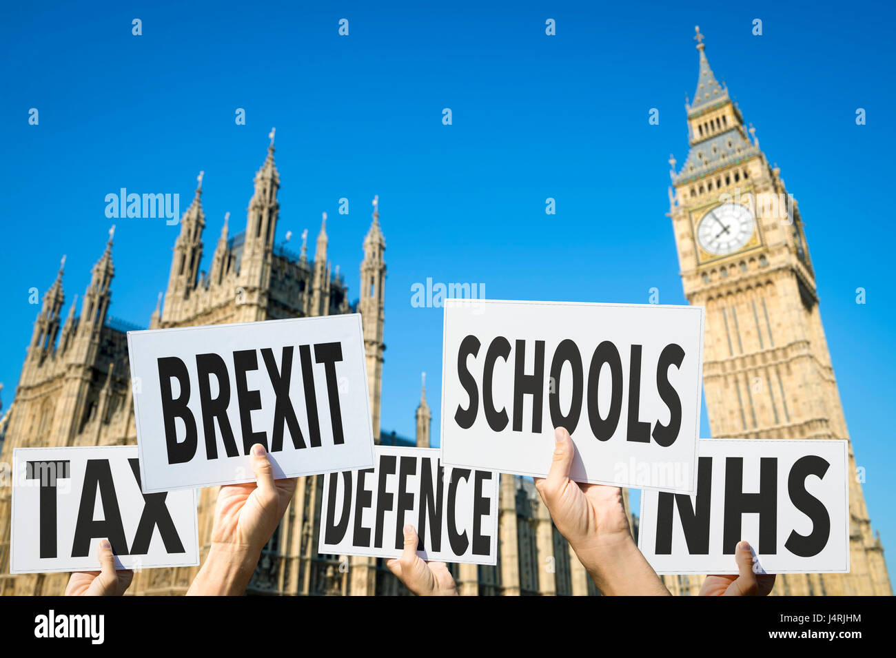 Election signs protesting modern British social issues like Brexit, tax, education, defense, health at the Houses - Stock Image