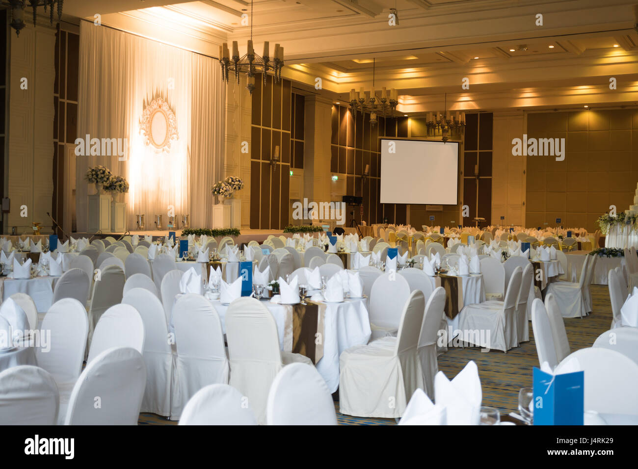 Beautiful  ballroom decorated for a wedding reception with clipping path of projector screen Stock Photo