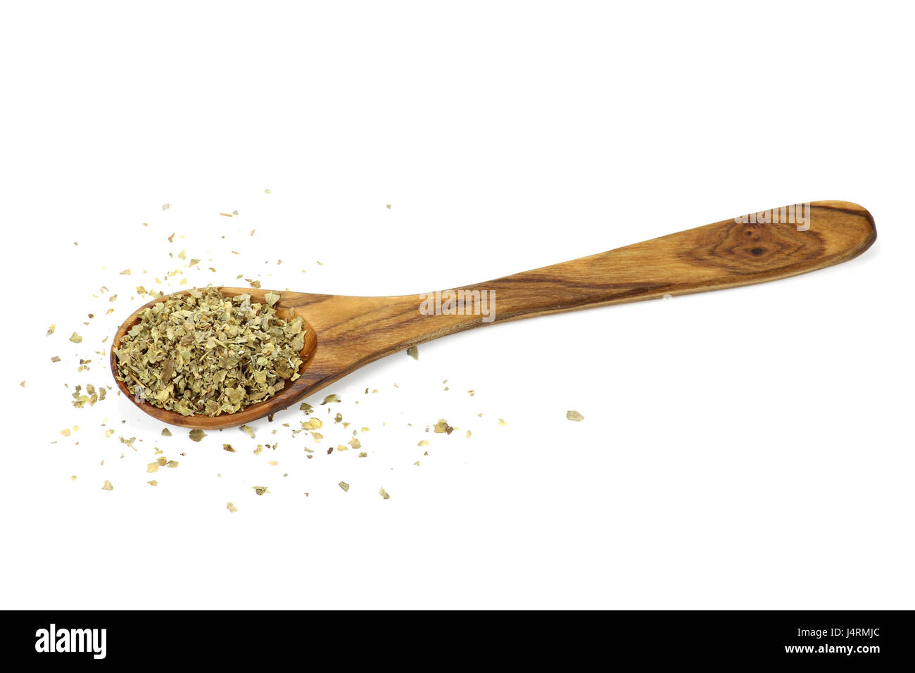 wooden spoon with marjoram isolated on white background - Stock Image