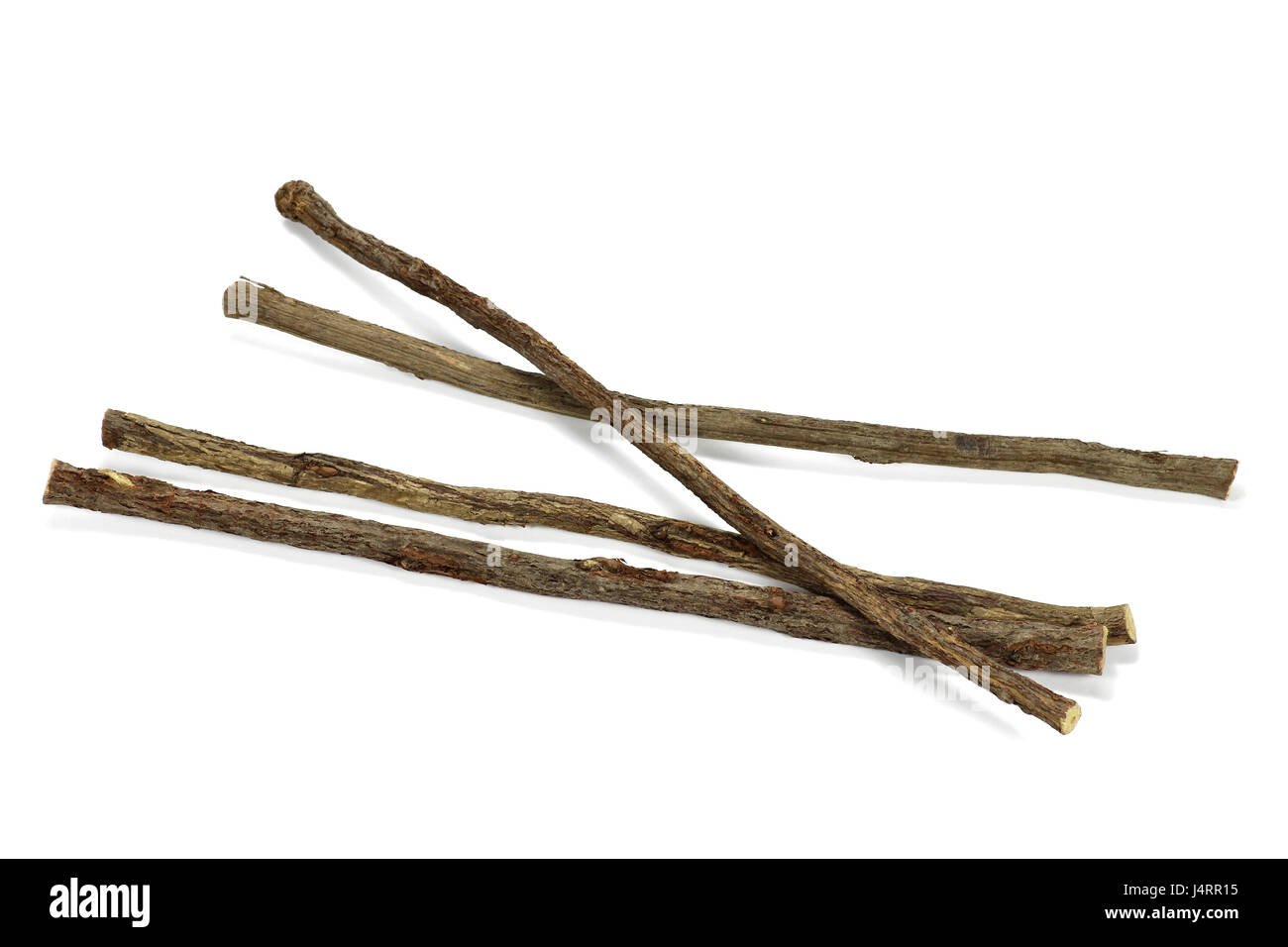 dried sticks of liquorice root isolated on white background - Stock Image