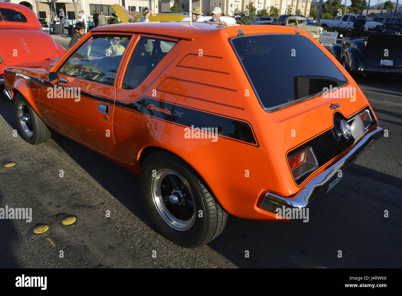 Gremlin, 1975 American Motors car, hatchback, 2 doors, orange. - Stock Image
