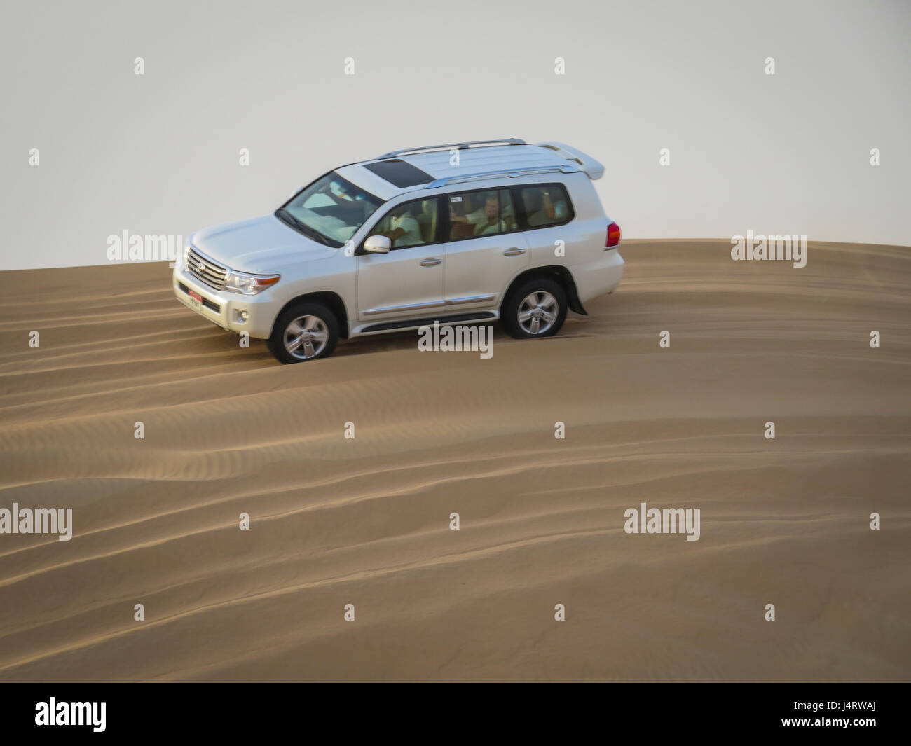 ARABIAN DESERT, ABU DHABI,UAE,8TH SEPT 2015:-Dune bashing at Dusk in 4 wheel drive trucks - Stock Image